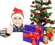 男孩圣诞节好的显示的符号结构树 库存图片