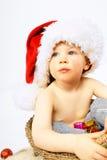 男孩圣诞节帽子一点 库存照片
