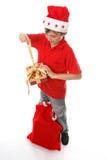男孩圣诞节开张存在 免版税库存照片