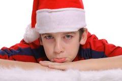 男孩圣诞节快活的噘嘴年轻人 库存图片