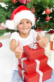 男孩圣诞节愉快的存在 库存照片