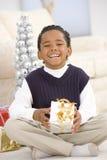 男孩圣诞节纵向存在 免版税库存照片