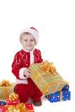 男孩圣诞节给玩具穿衣 免版税库存图片