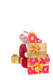男孩圣诞节给玩具穿衣 库存图片