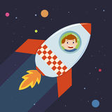 男孩在到空间的火箭队旅途上 库存照片