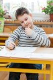 男孩在学校 图库摄影