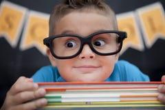 年轻男孩在教室 免版税库存图片
