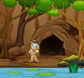 男孩在洞和河附近的探险家身分 皇族释放例证