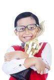 男孩感到骄傲为他的成就 库存图片