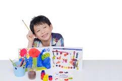 男孩在白色的绘画艺术 库存图片