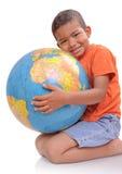男孩地球 库存图片