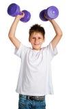男孩增强的重量 免版税库存照片