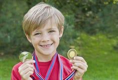 男孩奖牌 库存图片