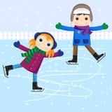 男孩女孩冰滑冰的一点 免版税库存照片