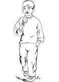 男孩奶油色吃冰 免版税图库摄影