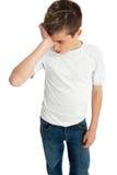 男孩子项强调了疲乏的翻倒 库存照片
