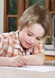 男孩家庭作业学习 免版税库存图片