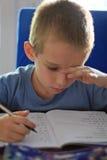 男孩家庭作业文字 免版税图库摄影