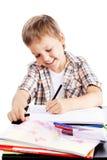 男孩家庭作业 库存图片
