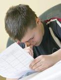 男孩家庭作业 库存照片