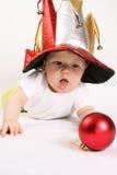 男孩小帽子的供人潮笑者 库存图片