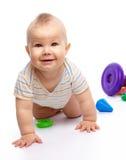 男孩少许作用玩具 免版税库存图片