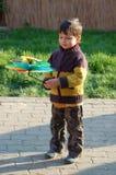 男孩少许使用的玩具 免版税图库摄影