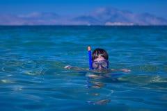 男孩少许屏蔽海运废气管 免版税库存图片
