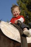 男孩少许骑马 库存照片