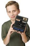 男孩展示快的照相机 库存照片