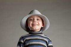 男孩帽子一点 库存图片