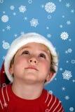 男孩帽子圣诞老人佩带的年轻人 免版税库存图片