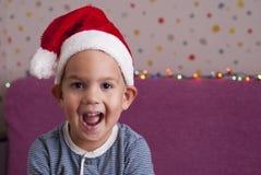 男孩帽子圣诞老人 免版税库存照片
