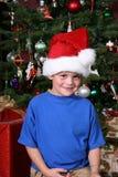 男孩帽子圣诞老人 免版税库存图片