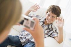 男孩微笑女孩的照片采取年轻人 库存照片