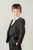 男孩微笑诉讼 图库摄影