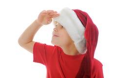男孩快乐的克劳斯帽子圣诞老人 免版税库存照片