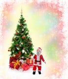 男孩快乐的克劳斯帽子圣诞老人 免版税库存图片