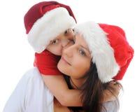 男孩快乐的克劳斯帽子圣诞老人 免版税图库摄影