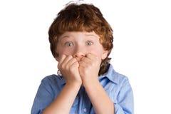 男孩惊吓了 背景查出的白色 免版税库存图片