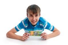 男孩愉快藏品货币微笑 免版税库存照片