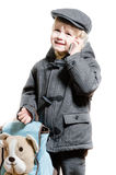 男孩或孩子谈话在手机愉快微笑 免版税库存照片