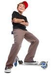 男孩把手滑行车开会 免版税库存图片