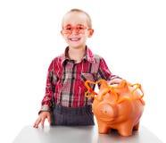 男孩挽救金钱 库存照片