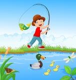 男孩捕鱼一点 库存照片