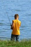 男孩捕鱼年轻人 图库摄影