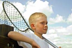 男孩捕鱼 图库摄影