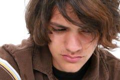 男孩接近哭泣的青少年  免版税图库摄影