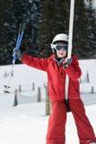 男孩推力滑雪 免版税库存照片