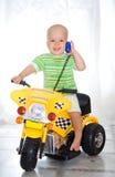男孩摩托车 免版税库存照片